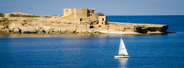 Qbajjar Bay and sailing boat