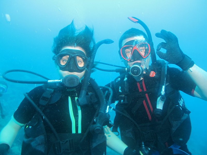 Happy Scuba Divers on European dive trip giving OK sign